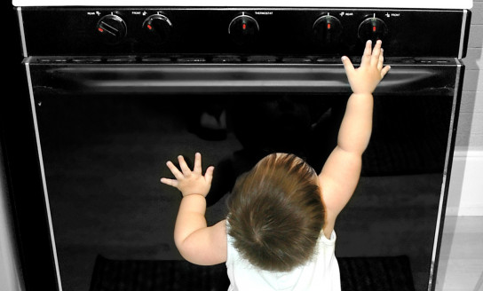 Baby Reaching for Stove 136754153 1317x2040