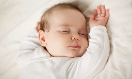 Sleeping newborn baby on white background. Small sleeping child bedtime baby up to one month 1005939262 2125x1416