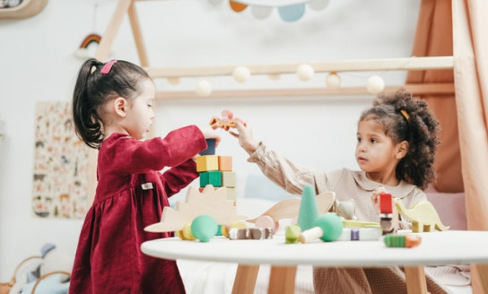 girl in red dress playing a wooden blocks 3662667