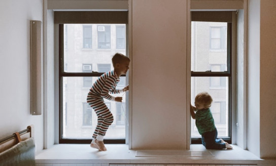 two kids playing beside glass windows 3273851