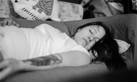 woman in white shirt sleeping on gray fabric sofa 156085